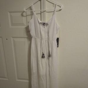 Brand new elegant white tropical dress.